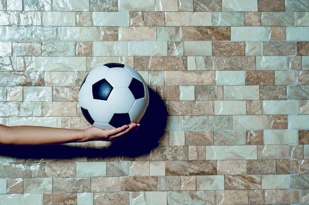 Jogador de futebol para exercer o conceito de futebol e há um espaço de cópia.