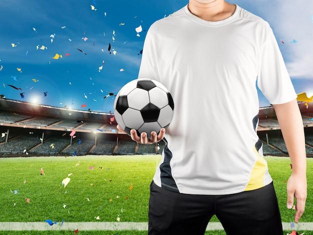Jogador de futebol segurando uma bola com o fundo do estádio