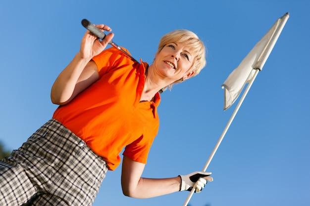 Jogador de golfe feminino sênior