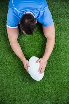 Jogador de rugby, marcando uma tentativa