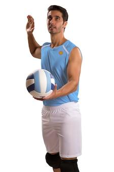 Jogador profissional de vôlei argentino com bola. isolado no espaço em branco.