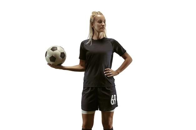 Jogadora de futebol treinando e treinando no estádio