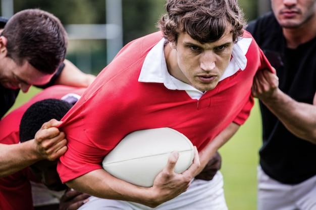 Jogadores de rugby, combater durante o jogo