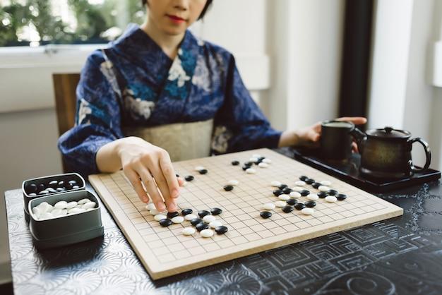 Jogando jogo wei qi