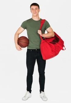 Jovem, adulto, muscular, homem, segurando, basquetebol