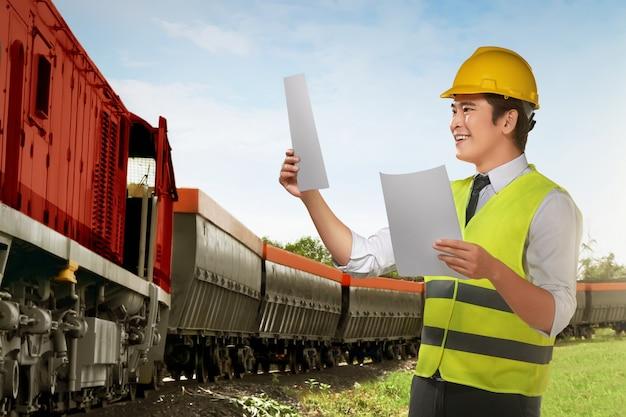 Jovem, asiático, trabalhador, verificar, trem, máquina