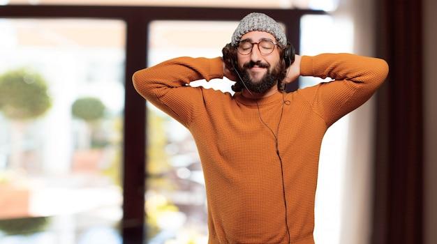 Jovem, barbudo, escutar, música