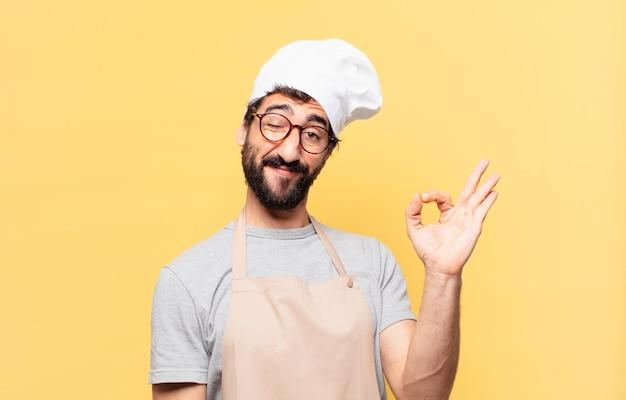 Jovem chef barbudo com expressão feliz