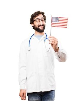 Jovem doutor com uma bandeira