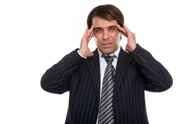 Jovem empresário persa estressado com dor de cabeça