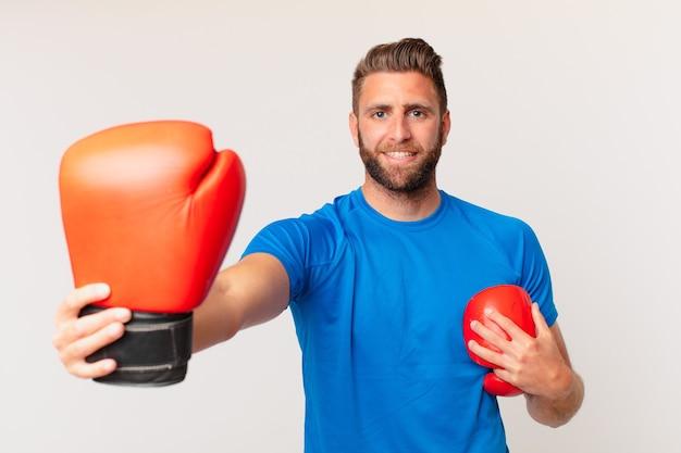 Jovem fitness com luvas de boxe
