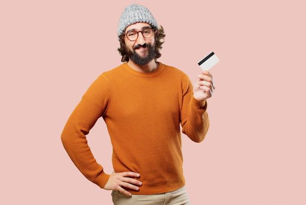 Jovem homem barbudo com cartão de crédito