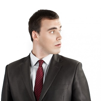 Jovem, homem negócios, olhando lateralmente