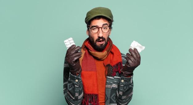 Jovem louco barbudo e vestindo roupas de inverno. conceito de doença