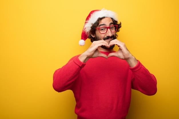 Jovem, louco, barbudo, homem, desgastar, vermelho, óculos, e, papai noel, chapéu