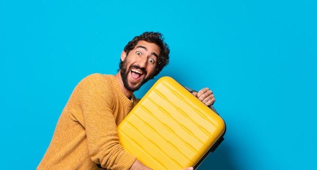 Jovem louco de barba com uma maleta