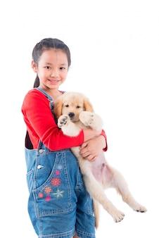 Jovem, menina asiática, segurando, dela, cão, e, sorrisos, sobre, fundo branco