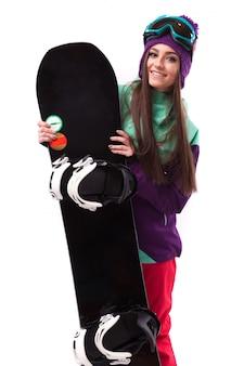 Jovem, mulher bonita, em, roxo, casaco esqui, e, óculos proteção, prender, snowboard