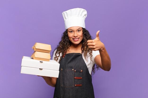 Jovem mulher bonita hispânica. conceito de chef de churrasco de expressão feliz e surpresa
