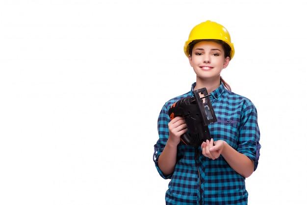 Jovem mulher no conceito industrial isolado no branco