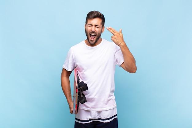 Jovem parecendo infeliz e estressado, gesto de suicídio fazendo sinal de arma com a mão, apontando para a cabeça