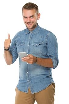 Jovem, segurando um telefone celular, polegar para cima