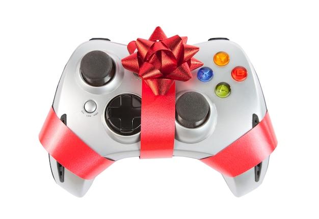 Joystick com fita vermelha e arco isolado no branco