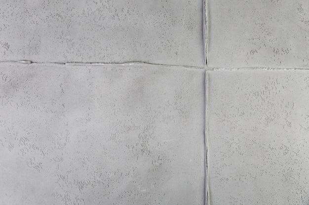 Junção de parede branca com textura áspera