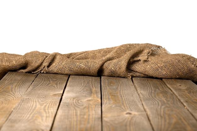 Juta de serapilheira ou saco em fundo branco de madeira