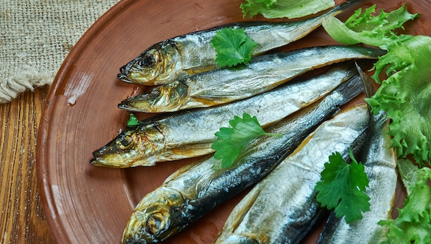 Kieler sprotte - peixe defumado nos países do norte da europa, incluindo os estados bálticos, escandinávia, irlanda, alemanha, polônia e rússia.