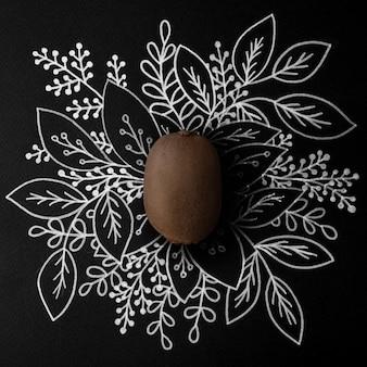 Kiwi sobre design floral de contorno