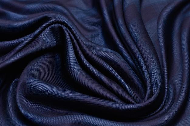 Lã xadrez clássica e elegante em azul e preto. tecido de terno masculino caro. caxemira virgem extra fina. manta de glen de fundo (verificação de glenurquhart) para design de moda. alta resolução