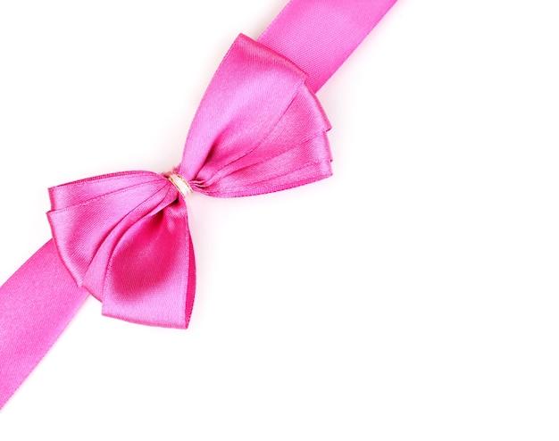 Laço de cetim rosa e fita isolado no branco