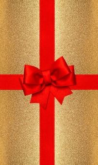 Laço de fita vermelha em fundo dourado. conceito de cartão-presente