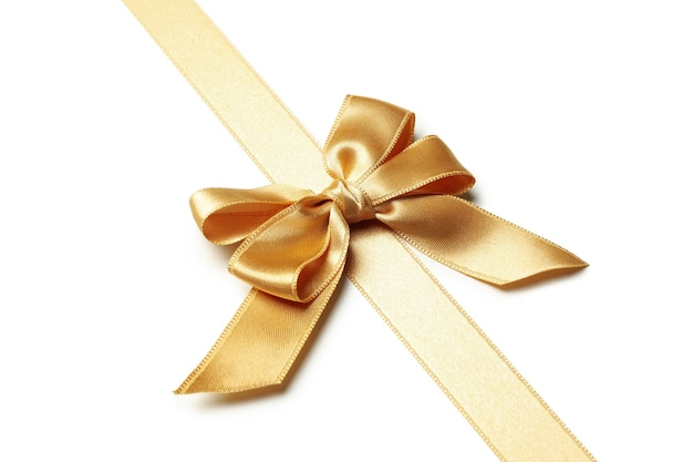 Laço de ouro para presente isolado no branco