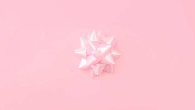 Laço rosa festivo em pastel rosa claro