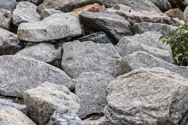 Lado da rocha de pedra de granito do oceano de água