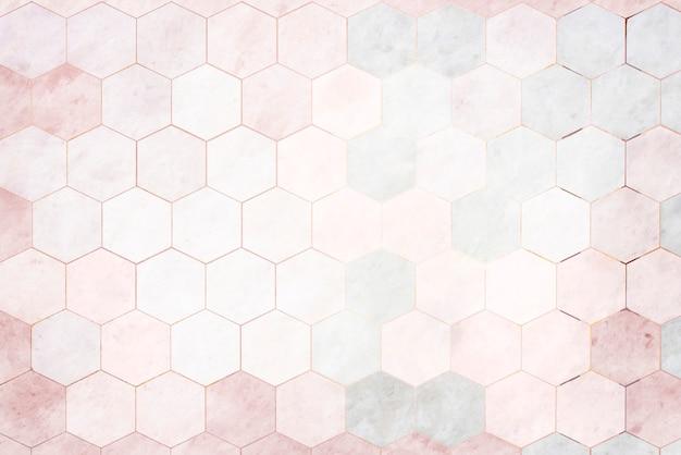 Ladrilhos de mármore rosa hexagonais com fundo estampado