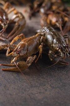 Lagosta, frutos do mar frescos prontos para cozinhar lanche de refeição de produto cru na mesa cópia espaço fundo de alimentos