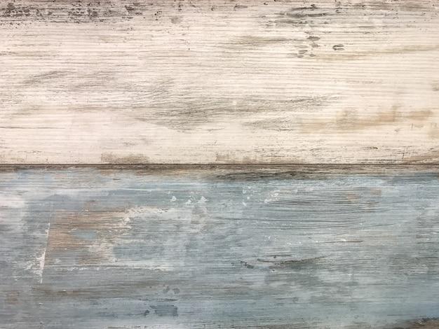 Laminado vintage branco e azul gasto. textura de madeira