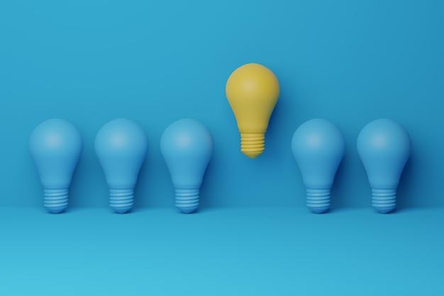 Lâmpada amarela flutuando destacada entre lâmpada azul-clara no fundo