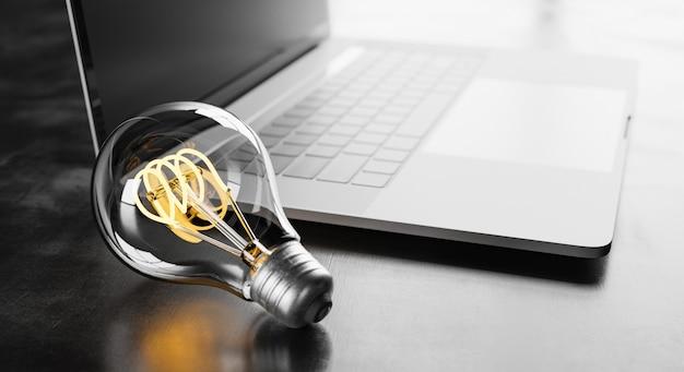 Lâmpada ao lado de um laptop