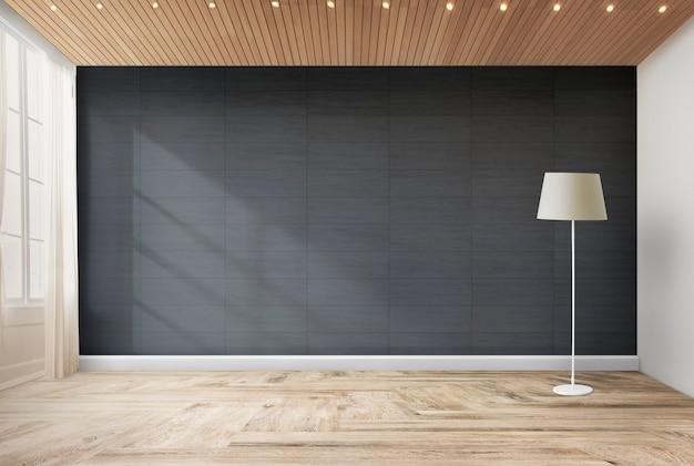 Lâmpada contra uma parede preta
