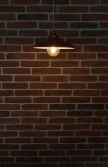 Lâmpada de suspensão na parede de tijolo