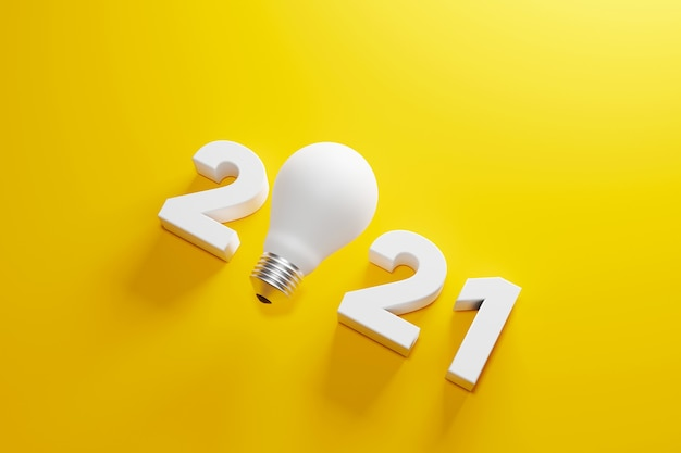 Lâmpada e 2021 ano novo em fundo amarelo solução e planejamento de negócios