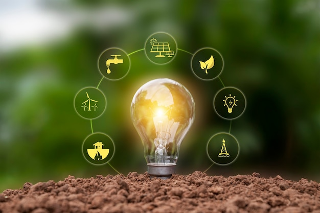 Lâmpada economizadora brilhante e ícone de energia baseado na terra, conceito de energia e ambiente.