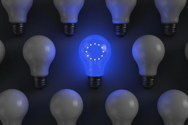 Lâmpada incandescente com os símbolos do tema economia política da união europeia
