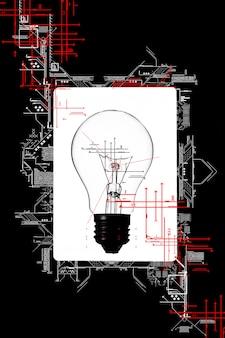 Lâmpada no fundo branco e preto. esquema de eletricidade. novo conceito de ideia.