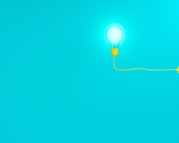 Lâmpadas amarelas de suspensão que incandescem no fundo pastel azul, ideia mínima do conceito