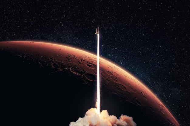 Lançamento de foguete para o planeta vermelho marte. a nave espacial decola em um espaço profundo estrelado com o planeta vermelho e o horizonte de marte. viagem de formigas da missão espacial